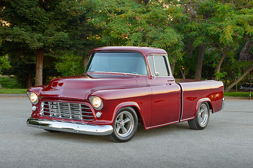 AUT 14 RK1831 01 © Kimball Stock 1955 Chevrolet Cameo Pickup Black Cherry 3/4 Front View On Pavement By Trees