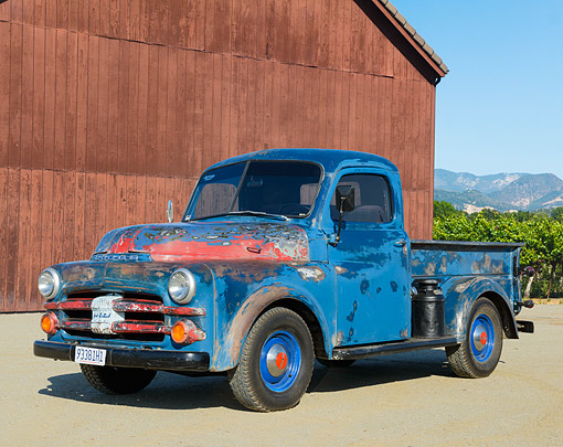 AUT 14 RK1840 01 © Kimball Stock 1952 Dodge B3B Pickup Blue 3/4 Front View On Gravel By Red Barn
