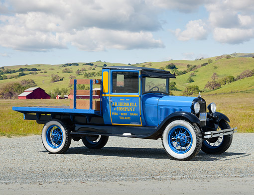 AUT 14 RK1844 01 © Kimball Stock 1928 Ford Model A Blue 3/4 Side View On Gravel By Grassy Hills