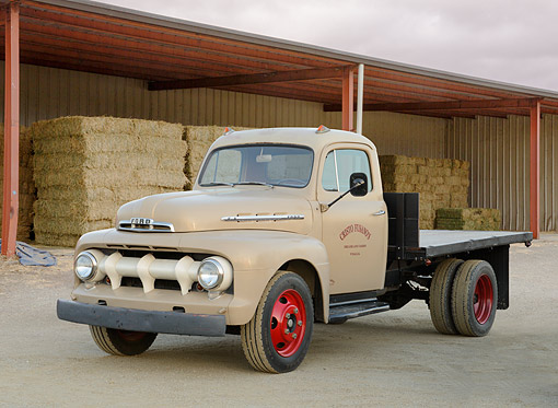AUT 14 RK1846 01 © Kimball Stock 1951 Ford F-1 Flatbed Pickup Tan 3/4 Front View On Gravel By Hay Bales