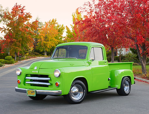 AUT 14 RK1850 01 © Kimball Stock 1954 Dodge Pickup C1-B6 Signal Green 3/4 Front View On Pavement By Autumn Trees