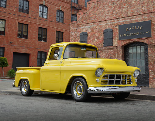 AUT 14 RK1851 01 © Kimball Stock 1956 Chevrolet Pickup Yellow 3/4 Front View On Pavement By Brick Building