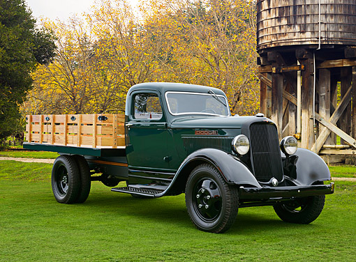 AUT 14 RK1854 01 © Kimball Stock 1934 Dodge Flatbed Pickup Green And Black 3/4 Front View On Grass By Water Tower
