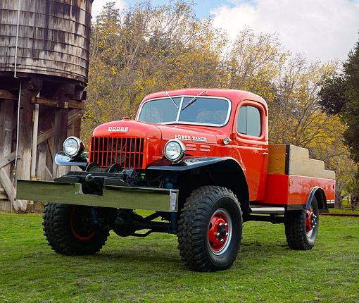 AUT 14 RK1855 01 © Kimball Stock 1947 Dodge Power Wagon Red 3/4 Front View On Grass By Water Tower
