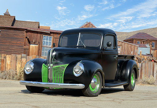 AUT 14 RK1864 01 © Kimball Stock 1940 Ford Truck Black Matte And Green 3/4 Front View On Pavement By Wood Houses