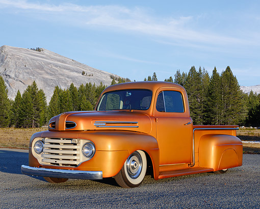 AUT 14 RK1865 01 © Kimball Stock 1950 Ford F-1 Truck Copper 3/4 Front View On Gravel By Mountains