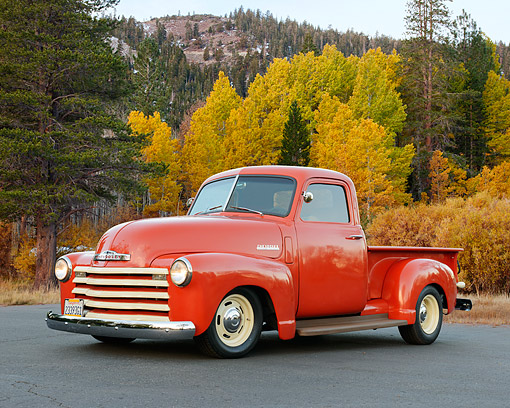 AUT 14 RK1868 01 © Kimball Stock 1953 Chevrolet Thriftmaster Red 3/4 Side View On Pavement By Autumn Trees
