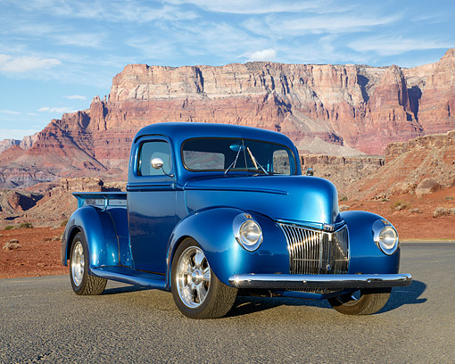 AUT 14 RK1870 01 © Kimball Stock 1940 Ford Pickup Truck Blue 3/4 Front View On Pavement In Desert