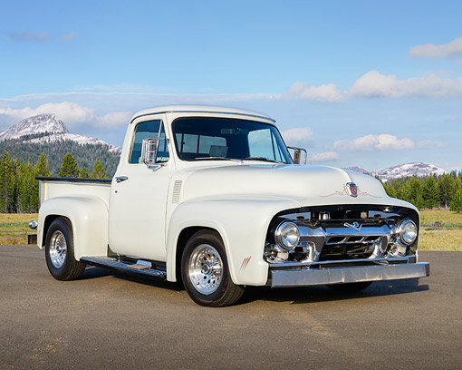 AUT 14 RK1873 01 © Kimball Stock 1954 Ford F-100 Pickup Truck White 3/4 Front View On Pavement By Mountains