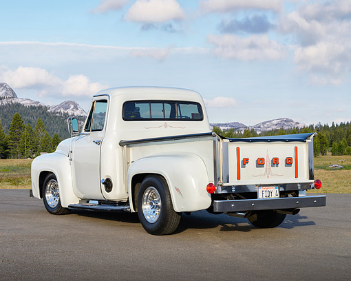 AUT 14 RK1874 01 © Kimball Stock 1954 Ford F-100 Pickup Truck White 3/4 Rear View On Pavement By Mountains