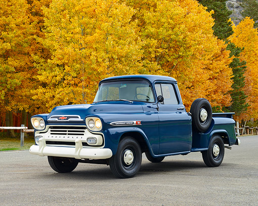 AUT 14 RK1875 01 © Kimball Stock 1959 Chevrolet 3100 Apache Pickup Truck Blue 3/4 Front View On Pavement By Autumn Trees