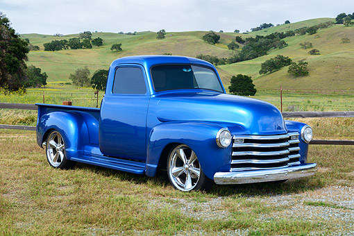 AUT 14 RK1880 01 © Kimball Stock 1951 Chevrolet 3100 Pickup Truck Blue 3/4 Front View On Grass By Hills