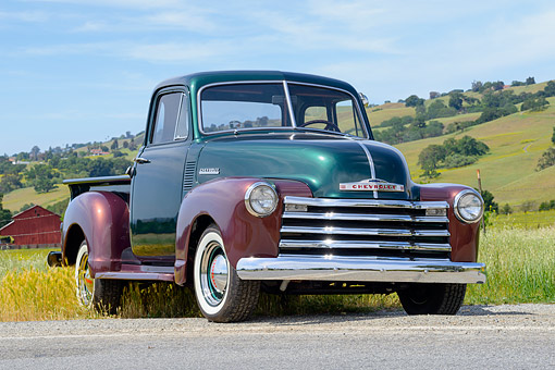 AUT 14 RK1881 01 © Kimball Stock 1952 Chevrolet 3100 Pickup Truck Green And Brown 3/4 Front View On Grass By Hills