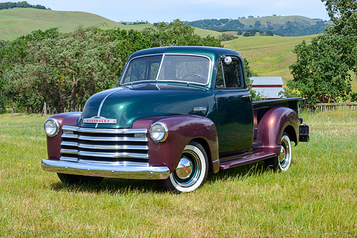 AUT 14 RK1883 01 © Kimball Stock 1952 Chevrolet 3100 Pickup Truck Green And Brown 3/4 Front View On Grass By Hills