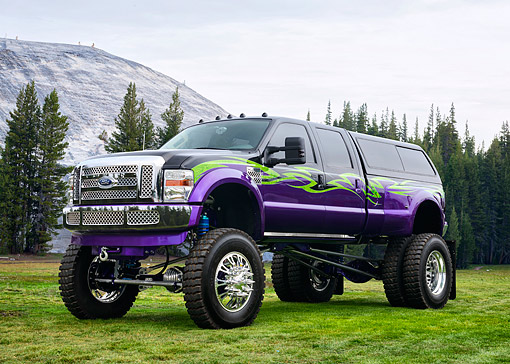 AUT 14 RK1885 01 © Kimball Stock 2008 Ford F-450 Custom Truck Black And Purple 3/4 Front View In Forest Meadow