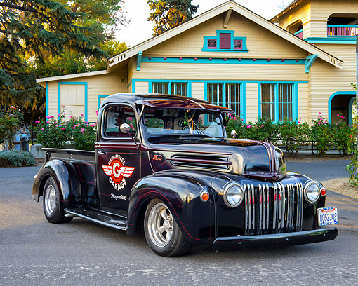 AUT 14 RK1887 01 © Kimball Stock 1946 Ford Truck Black 3/4 Front View In Front Of House