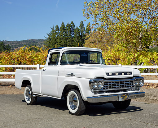 AUT 14 RK1888 01 © Kimball Stock 1959 Ford F-100 Pickup White With Blue Top 3/4 Front View In Autumn Vineyard