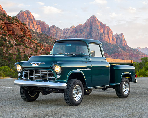 AUT 14 RK1897 01 © Kimball Stock 1955 Chevrolet Pickup 3100 Green 3/4 Front View On Pavement In Desert