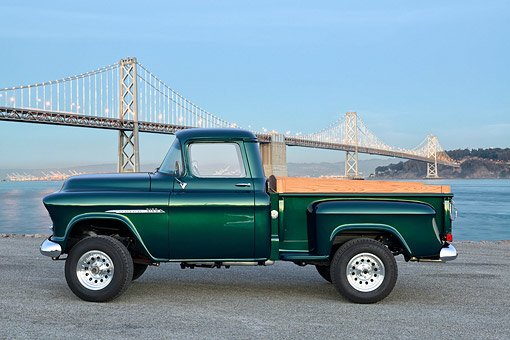 AUT 14 RK1900 01 © Kimball Stock 1955 Chevrolet Pickup 3100 Green Profile View By Bridge