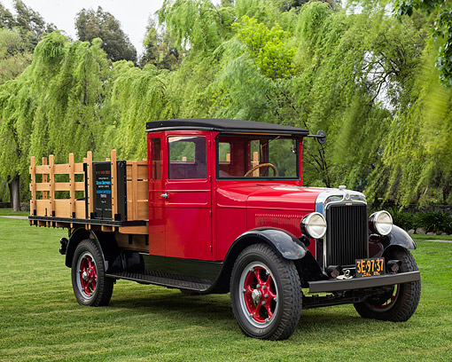 AUT 14 RK1901 01 © Kimball Stock 1929 Graham Brothers Stakebed Truck Red 3/4 Front View On Grass