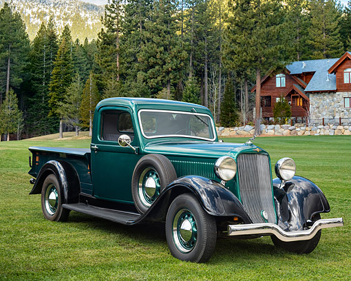 AUT 14 RK1916 01 © Kimball Stock 1935 Dodge KCL Pickup Truck Green 3/4 Front View On Grass By Log Cabin