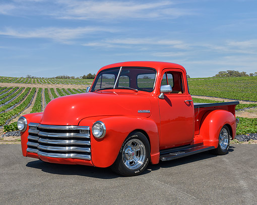 AUT 14 RK1917 01 © Kimball Stock 1953 Chevrolet Stepside Pickup Red 3/4 Front View On Farm