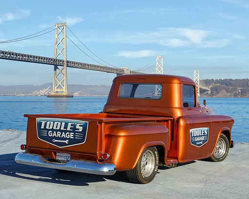 AUT 14 RK1921 01 © Kimball Stock 1956 Chevrolet Pickup Metallic Rust Orange 3/4 Rear View Looking Over Bay