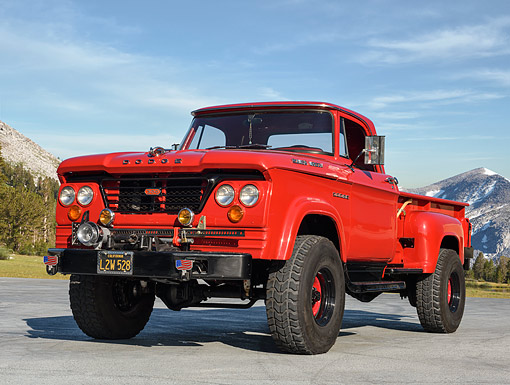 AUT 14 RK1923 01 © Kimball Stock 1965 Dodge W300 Power Wagon Red 3/4 Front View On Pavement By Forest Mountains