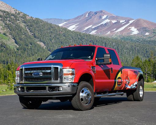 AUT 14 RK1925 01 © Kimball Stock 2008 Ford F-350 Red With Custom Graphics On Pavement By Forest Mountain