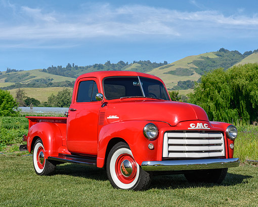AUT 14 RK1929 01 © Kimball Stock 1953 GMC 3 Window Pickup Red 3/4 Front View On Grass By Lake