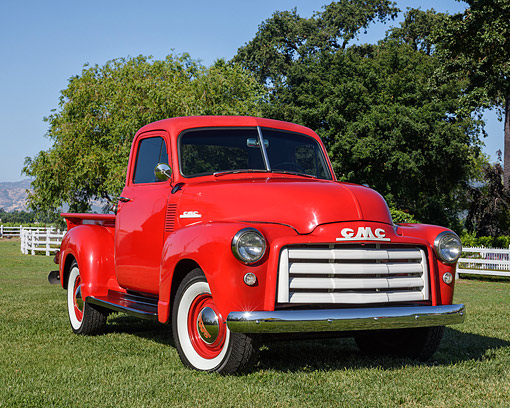 AUT 14 RK1930 01 © Kimball Stock 1953 GMC 3 Window Pickup Red 3/4 Front View On Grass By Fence