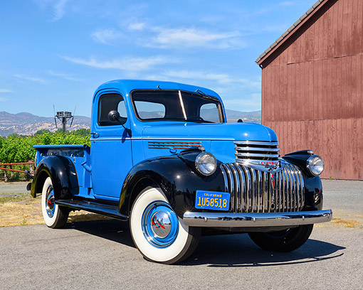 AUT 14 RK1935 01 © Kimball Stock 1946 Chevrolet Pickup Blue And Black 3/4 Front View On Farm