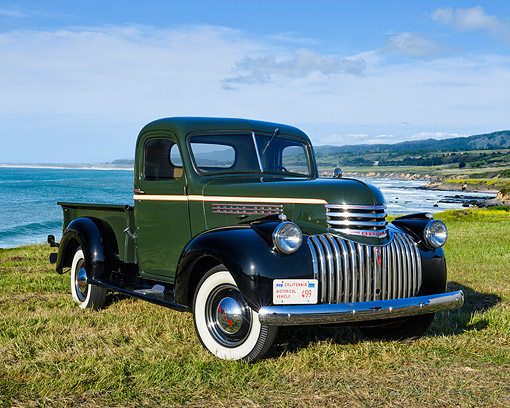 AUT 14 RK1936 01 © Kimball Stock 1946 Chevrolet 3100 1/2 Ton Pickup Green And Black 3/4 Front View On Grass By Ocean