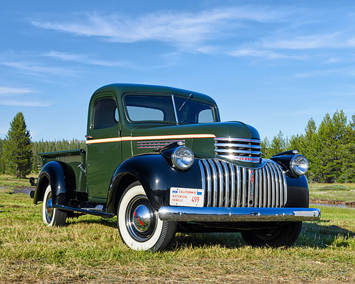 AUT 14 RK1937 01 © Kimball Stock 1946 Chevrolet 3100 1/2 Ton Pickup Green And Black 3/4 Front View On Grass By Forest