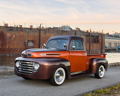 AUT 14 RK1940 01 © Kimball Stock 1950 Ford F-1 Pickup Custom Orange And Brown 3/4 Front View On Dock