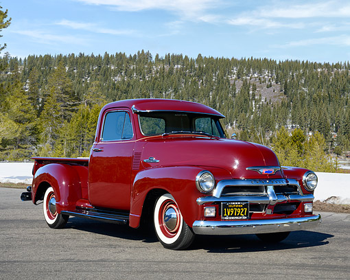 AUT 14 RK1946 01 © Kimball Stock 1955 Chevrolet Pickup 1st Series Maroon 3/4 Front View By Trees And Mountain