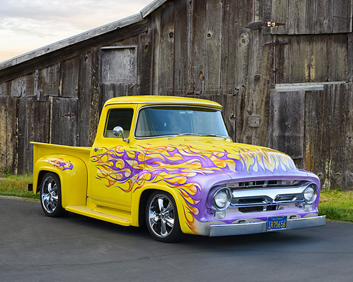 AUT 14 RK1951 01 © Kimball Stock 1956 Ford Pickup Yellow With Purple Flames 3/4 Front View By Barn