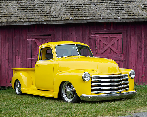 AUT 14 RK1954 01 © Kimball Stock 1947 Chevrolet Pickup Custom Yellow 3/4 Front View On Grass By Barn