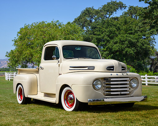 AUT 14 RK1956 01 © Kimball Stock 1950 Ford F-1 Pickup Vanilla 3/4 Front View On Grass By Trees