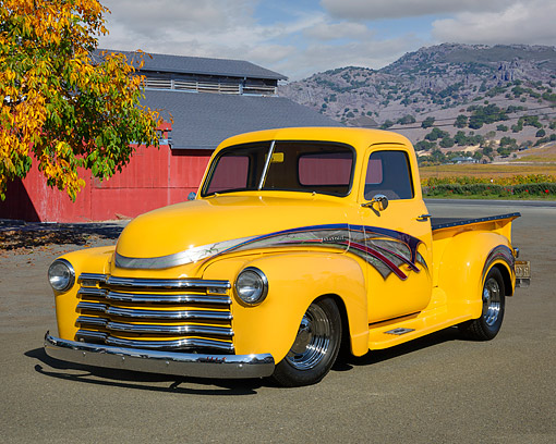 AUT 14 RK1968 01 © Kimball Stock 1950 Chevrolet Pickup Custom Yellow With Graphics 3/4 Front View By Building And Vineyard
