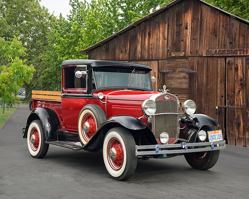 AUT 14 RK1970 01 © Kimball Stock 1931 Ford A Deluxe Pickup Red And Black 3/4 Front View By Blacksmith Shop