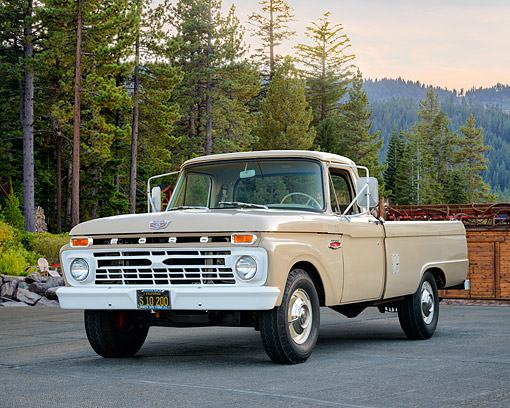 AUT 14 RK1977 01 © Kimball Stock 1966 Ford F-250 Camper Special Pickup Beige 3/4 Front View By Trees