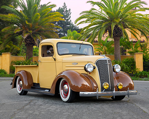 AUT 14 RK1984 01 © Kimball Stock 1937 Chevrolet Pickup 1/2 Ton Beige 3/4 Front View By House And Palm Trees