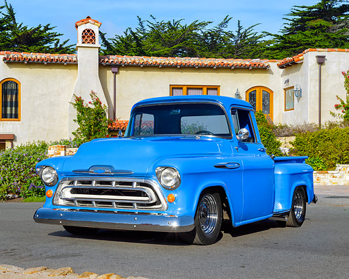 AUT 14 RK1990 01 © Kimball Stock 1957 Chevrolet 3100 Pickup Blue 3/4 Front View By Building And Trees