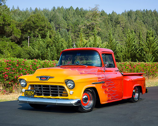 AUT 14 RK1991 01 © Kimball Stock 1955 Chevrolet 3100 Custom Pickup Red With Flames 3/4 Front View On Pavement By Trees