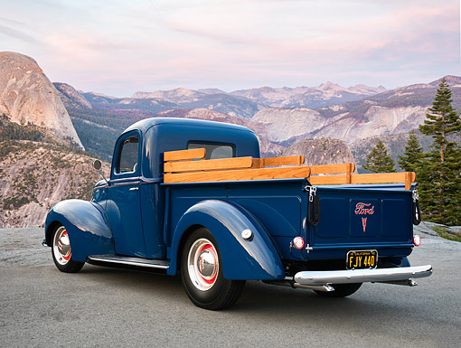 AUT 14 RK1995 01 © Kimball Stock 1940 Ford Pickup Blue 3/4 Rear View By Mountains And Trees