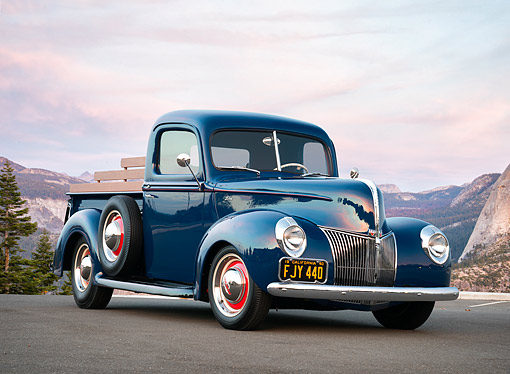 AUT 14 RK1996 01 © Kimball Stock 1940 Ford Pickup Blue 3/4 Front View By Mountains And Trees