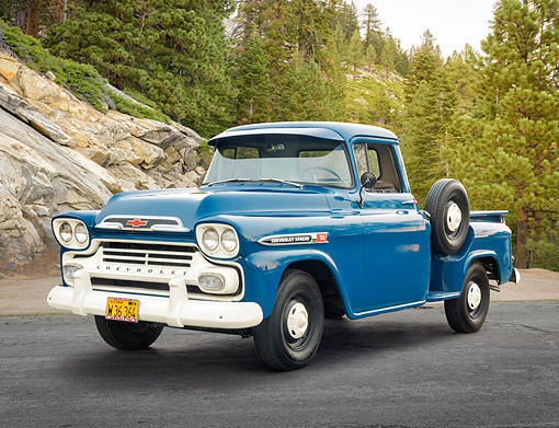AUT 14 RK2005 01 © Kimball Stock 1959 Chevrolet Apache 31 Blue 3/4 Front View By Trees