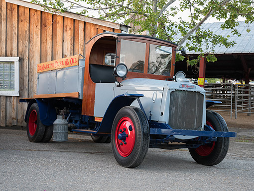 AUT 14 RK2014 01 © Kimball Stock 1925 De Martini Fuel Truck 3/4 Front View By Barn