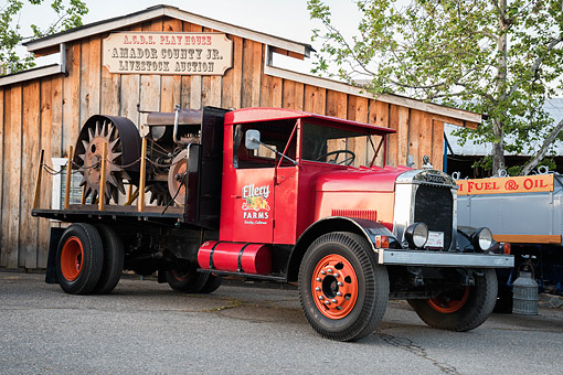 AUT 14 RK2015 01 © Kimball Stock 1929 Fagoel 360 Red With Tractor 3/4 Front View By Barn